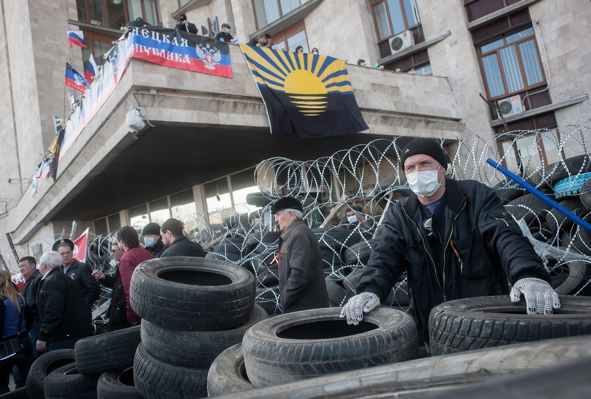 "Pro-Russia militants seized the regional administration building in Donetsk, Ukraine, over the weekend and unfurled a banner Monday proclaiming the independent ""Donetsk Republic"" in a move mimicking the Russian takeover of Ukraine's Crimea region five weeks ago."