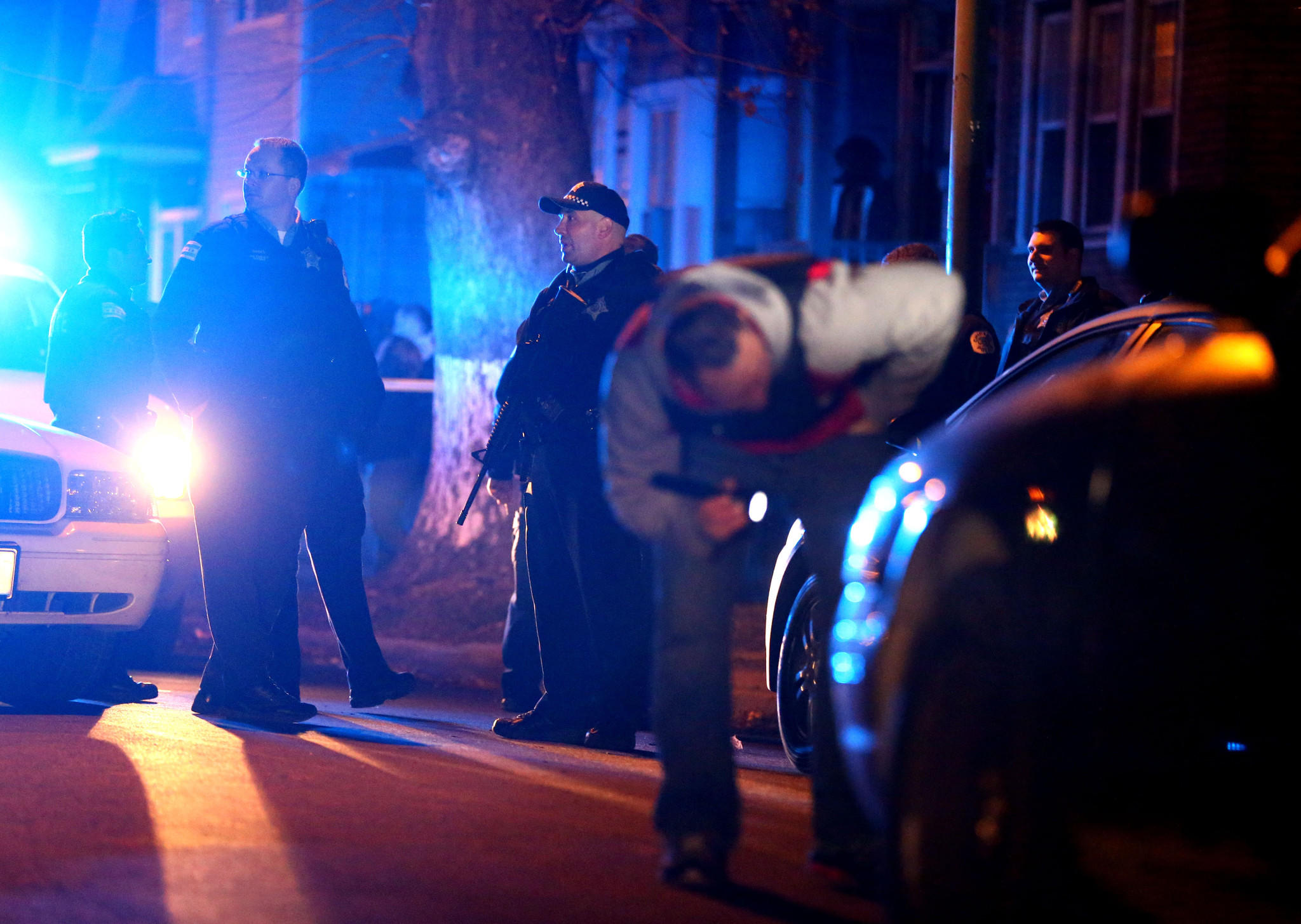 Chicago police work the scene of a multiple shooting in the 4200 block of South Wells Street in Chicago in November 2012.