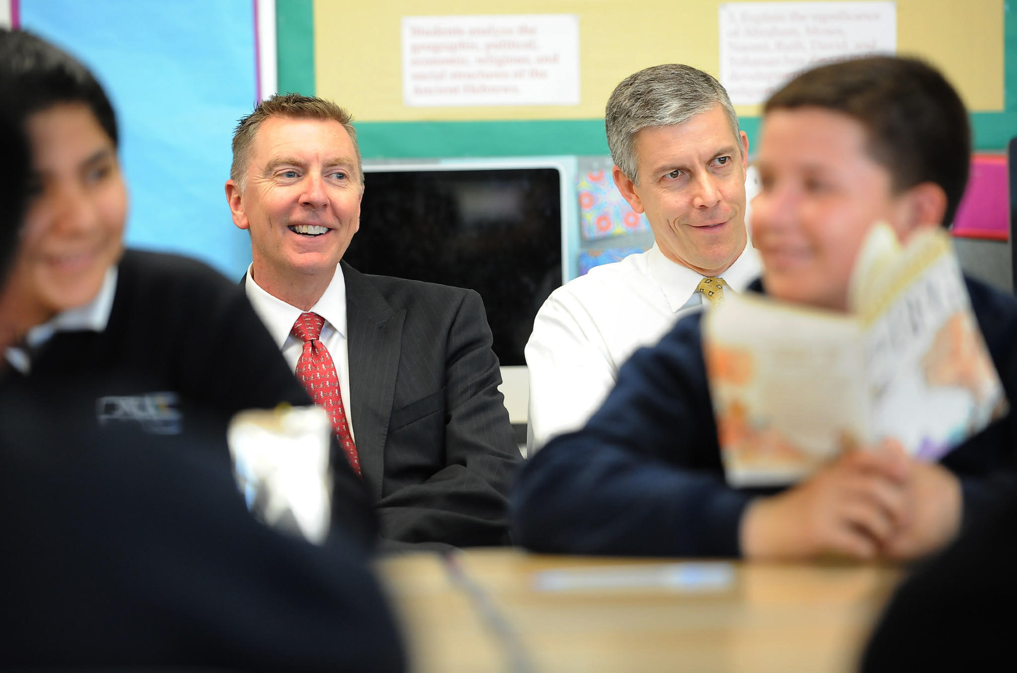 L.A. Unified Superintendent John Deasy, rear left, sits beside U.S. Secratary of Education Arne Duncan in a reading class at Dr. Julian Nava Learning Academy in Los Angeles.