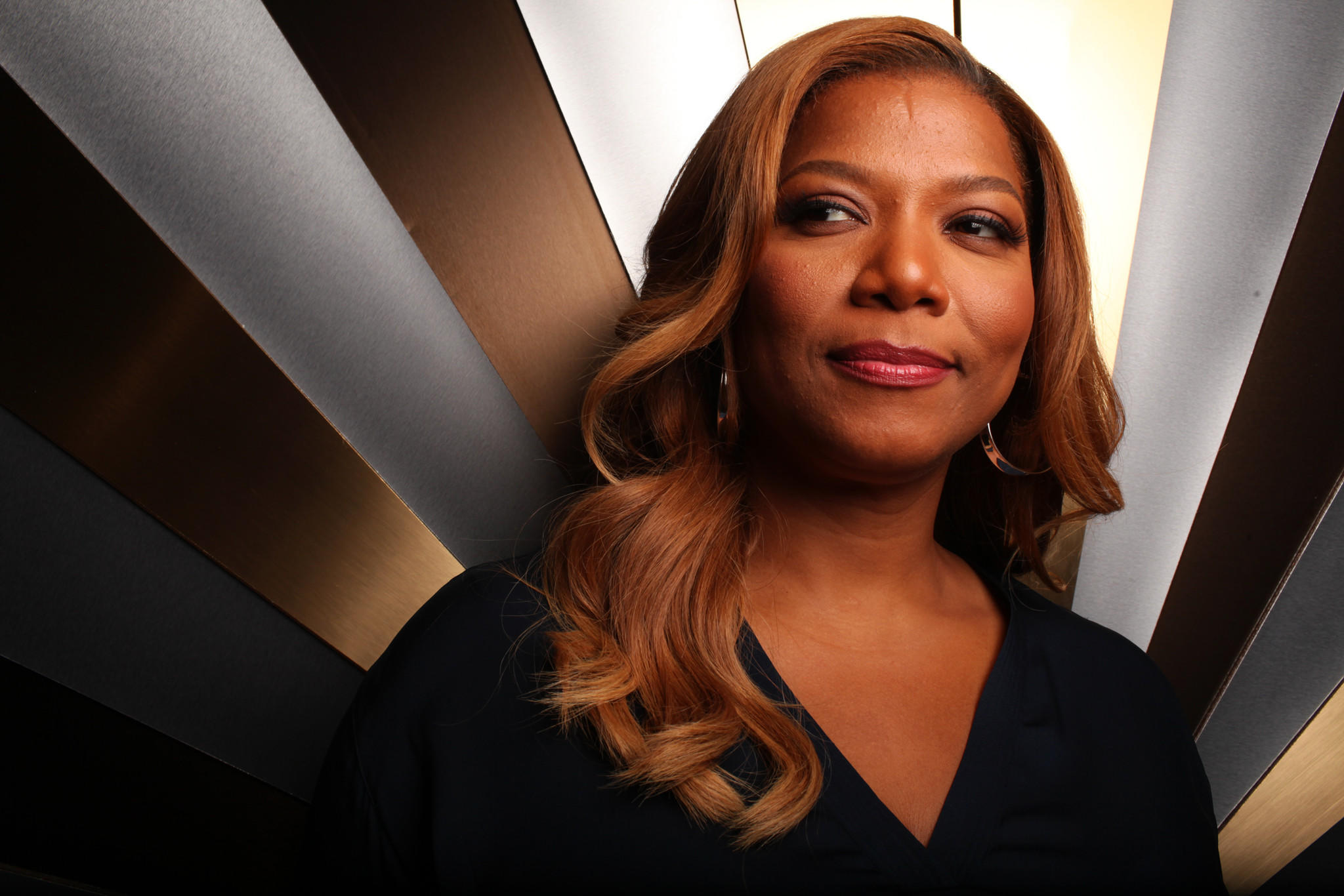 """Queen Latifah on the set of """"The Queen Latifah Show."""" BET's Centric will air the talk show in prime time and has also picked up the VH1-canceled """"Single Ladies,"""" which comes from her production company."""