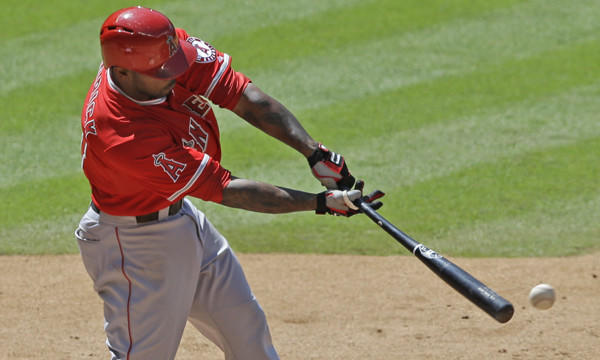 Angels second baseman Howie Kendrick connects on a run-scoring single during the seventh inning of the Angels' 9-1 victory over the Houston Astros on Monday.
