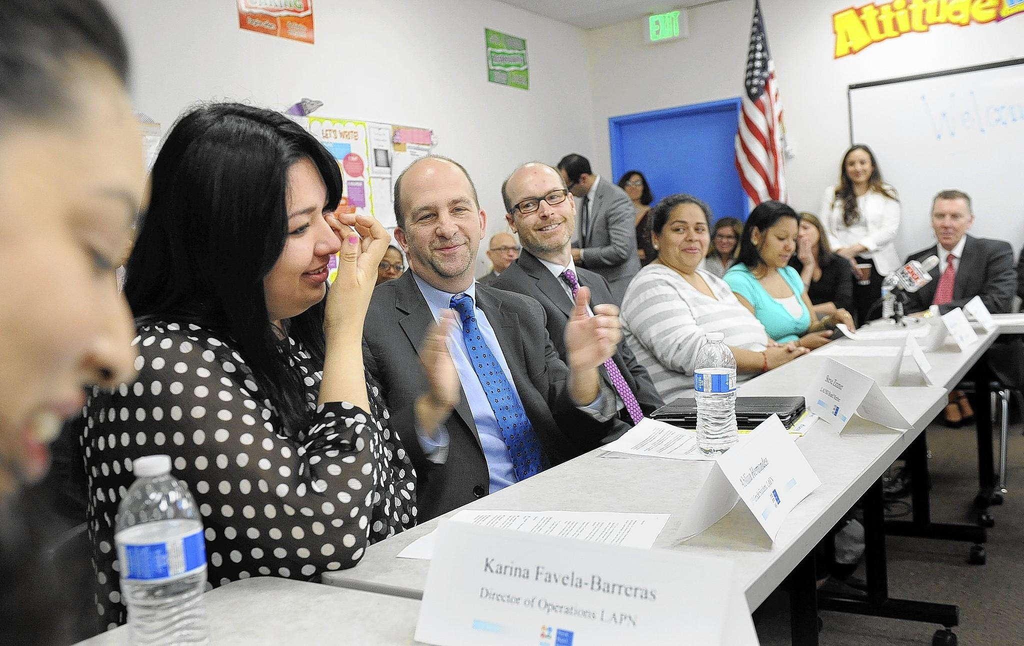 If the Los Angeles school board approves having a student advisory member, the student would provide guidance on issues and cast an advisory vote just before the board's official vote. Above, 11th-grader Ablina Hernandez, second from left, takes part in a roundtable discussion at the Youth Policy Institute in L.A.
