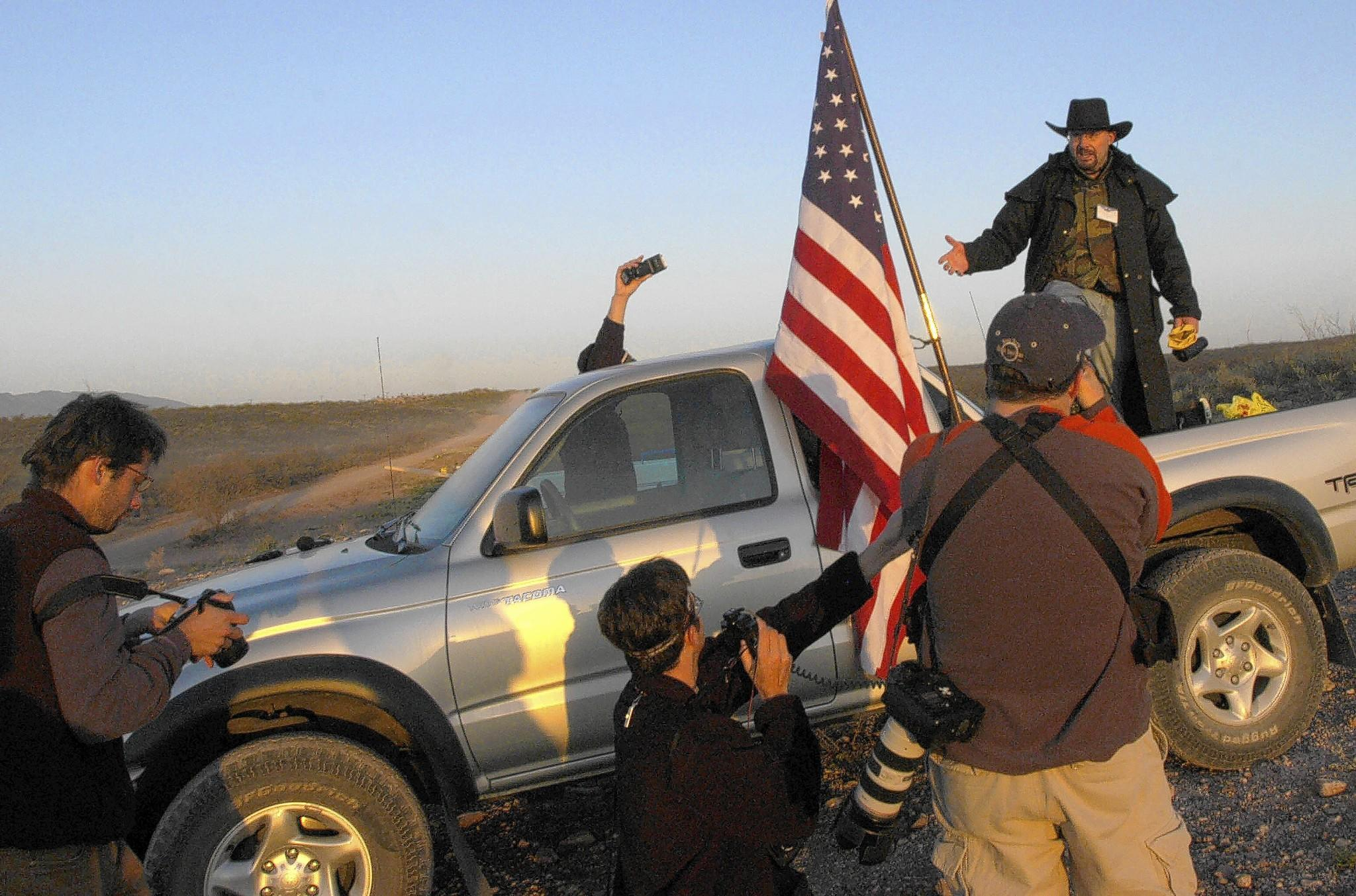 In April 2005, Minuteman volunteer Tim Donnelly speaks to journalists after spending the night monitoring the U.S.-Mexico border near Douglas, Ariz.