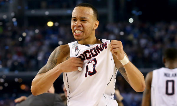 Connecticut's Shabazz Napier celebrates the Huskies' 60-54 national title victory over Kentucky on Monday.