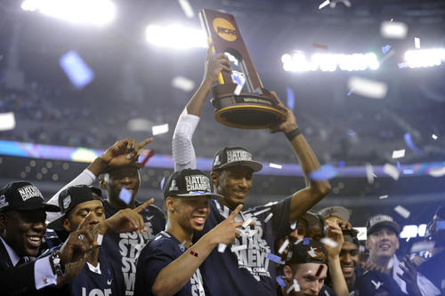 Shabazz Napier signals that he has won two national championships.