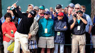 Practice resumes with dry weather at the Masters
