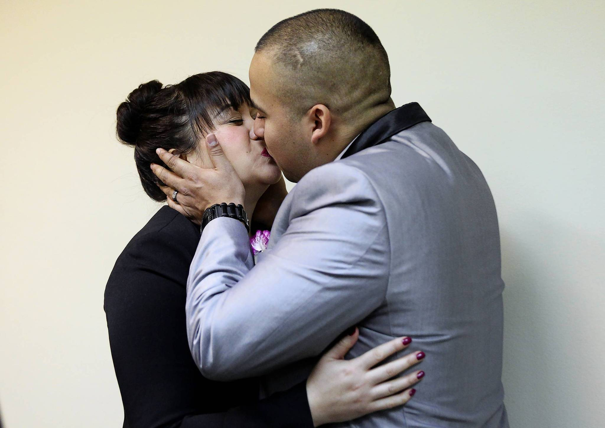 A man and a woman kiss