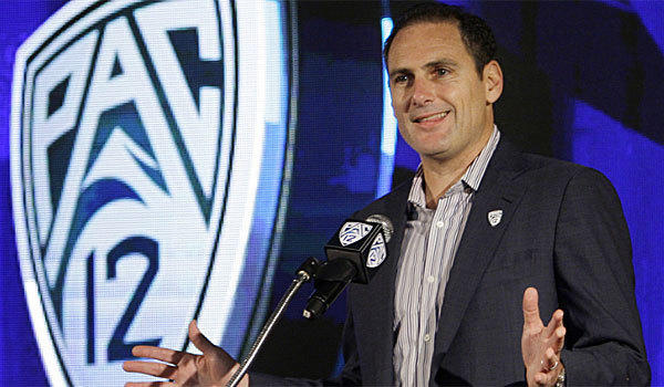 Pac-12 Commissioner Larry Scott, shown in 2011, wrote an op-ed piece in USA Today against a ruling that would allow Northwestern football players to form a union.