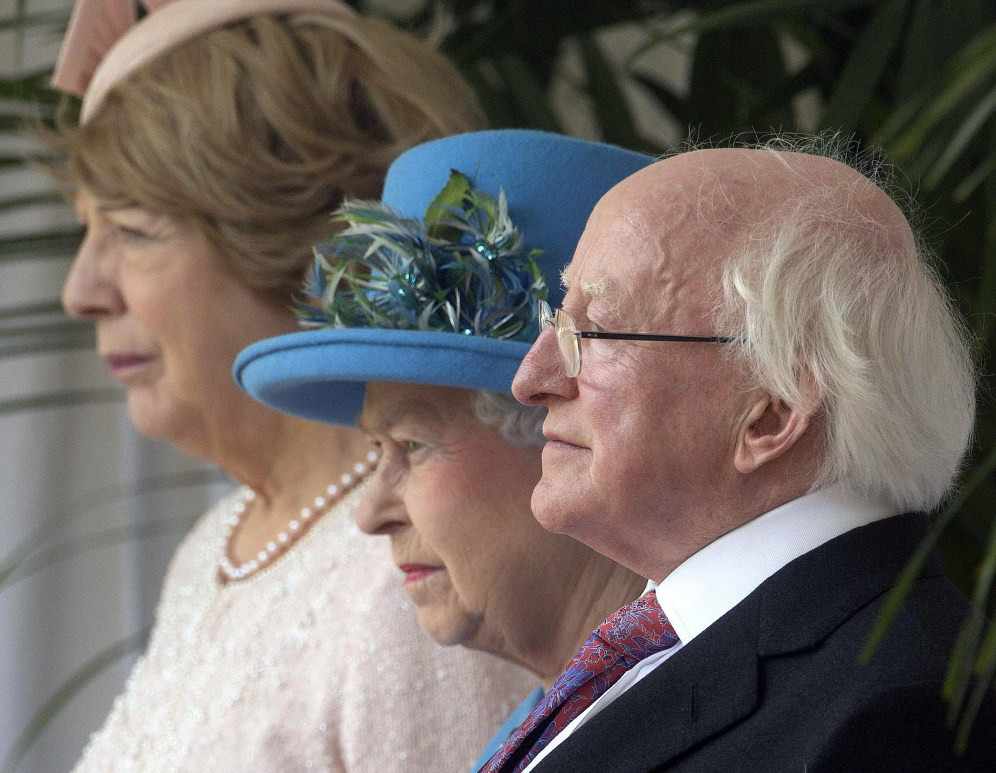 Britain's Queen Elizabeth II is flanked by Irish President Michael D. Higgins and his wife, Sabina, during an official welcoming ceremony for Higgins at Windsor Castle.
