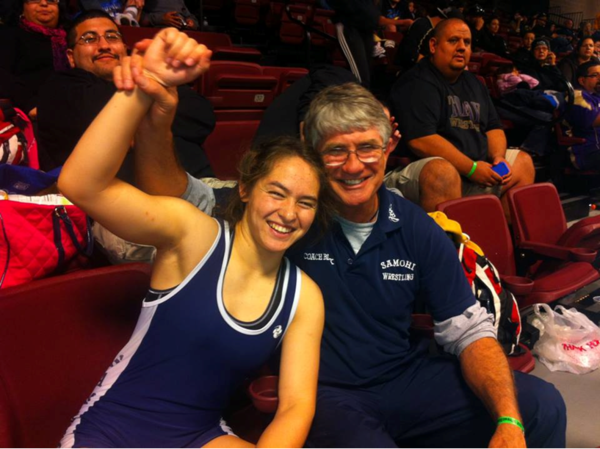 Santa Monica High School wrestling coach Mark Black with Maddy Tung