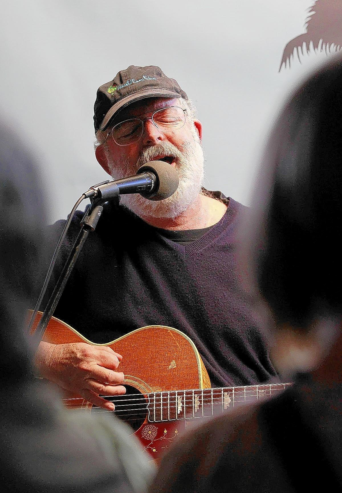 """Singer/songwriter Jack Tempchin sings """"Peacful Easy Feeling,"""" the song he wrote that became a classic for The Eagles, during a performance at the Wine Gallery on Thursday."""
