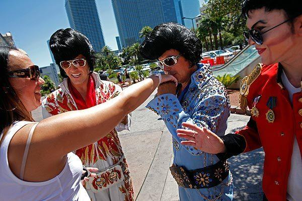 A tourist meets a few characters in Las Vegas. Sin City is expected to be the top destination for Southern California travelers during spring vacations.