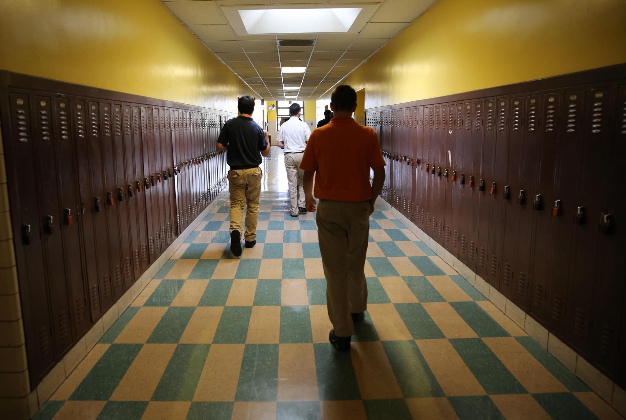 Gordon Tech students walk back toward their classroom after taking their standardized testing exams at Gordon Tech High School.