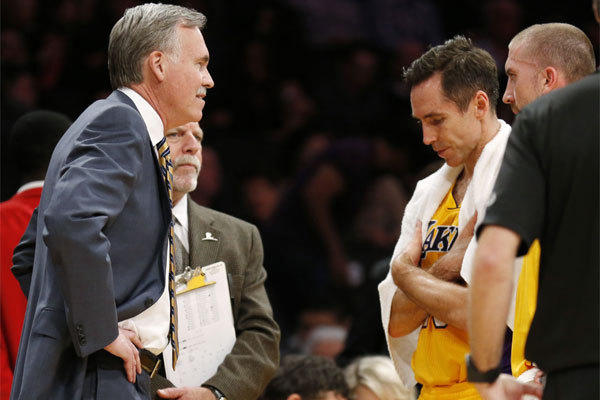 Steve Nash talks with Coach Mike D'Antoni during the Lakers' game against Utah on Feb. 11.