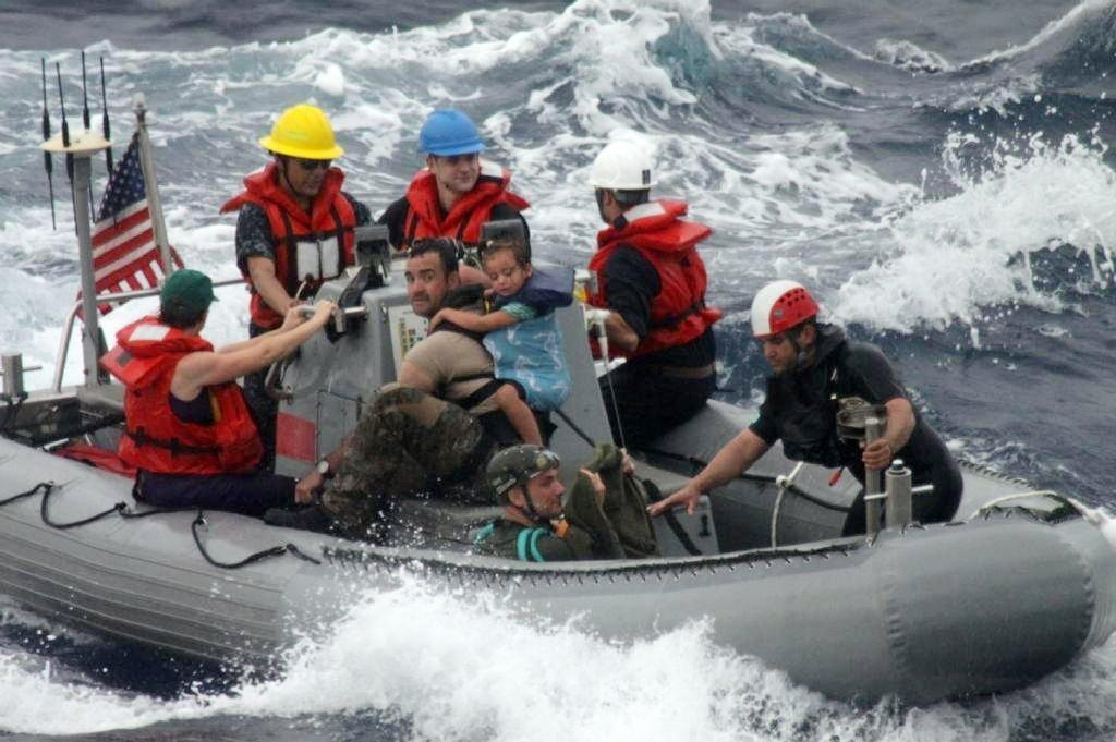 Sailors from the Navy frigate Vandegrift assist in the rescue of the Kaufman family on Sunday.