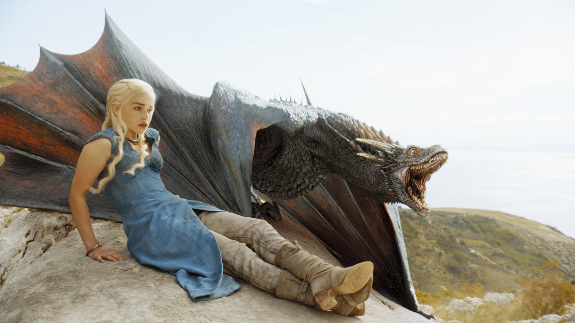 """Emilia Clarke with one of her dragons on """"Game of Thrones."""""""
