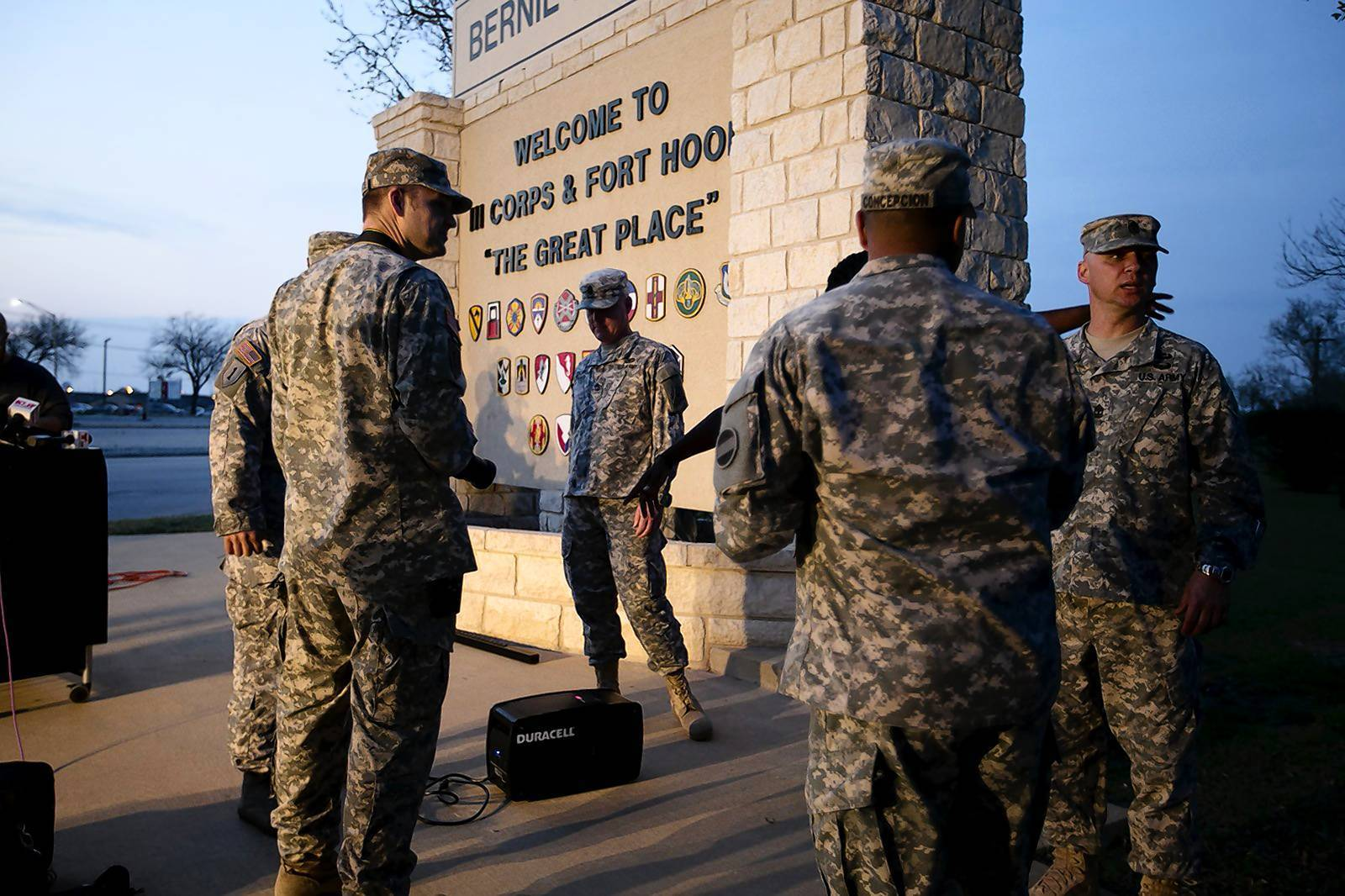 Military personnel wait for a news conference to begin at Fort Hood, Texas.