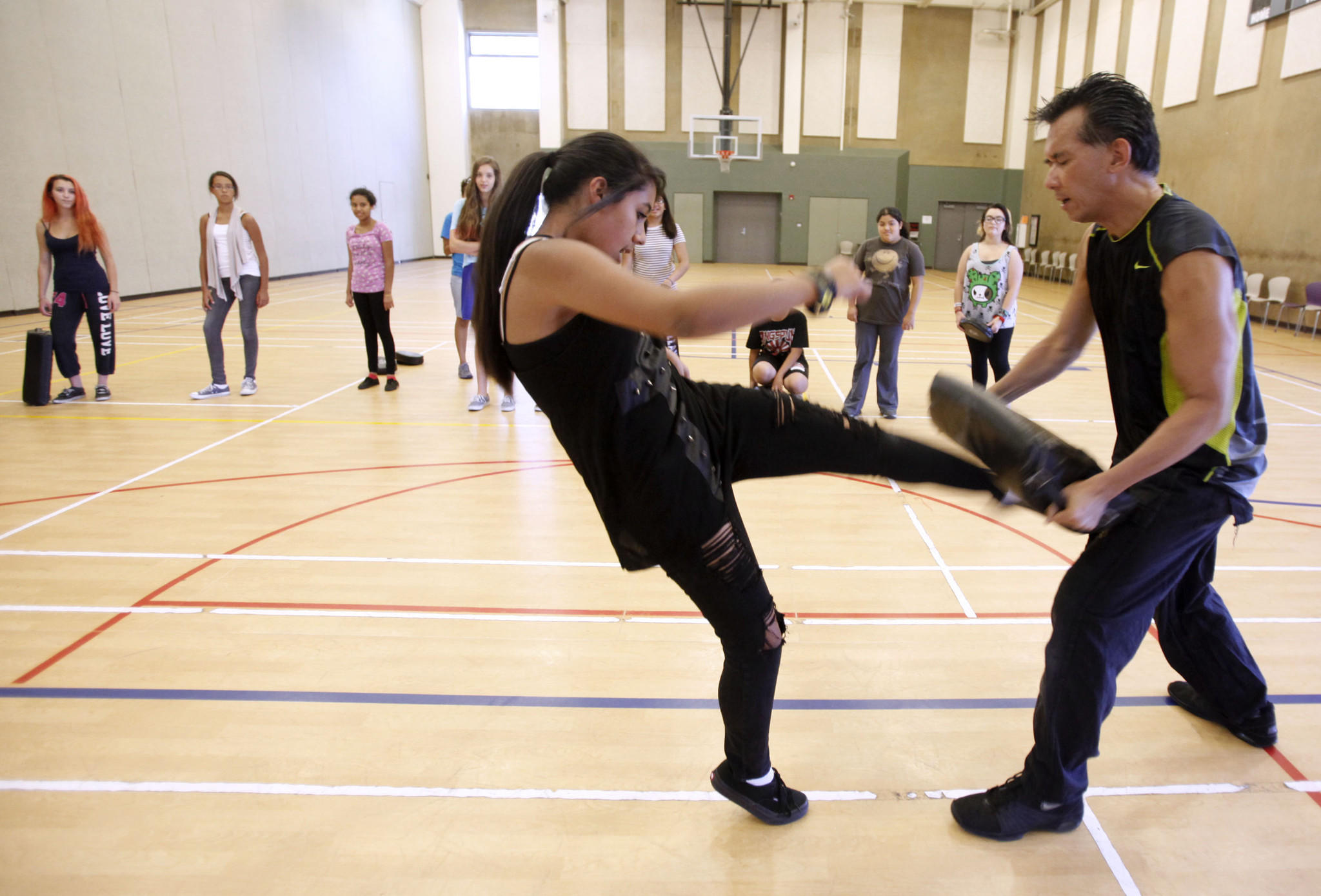 Alexandria Meneses, 15, of Burbank, learns self-defense techniques from instructor Nelson Nio at Pacific Community Center in Glendale on Tuesday, July 16, 2013.