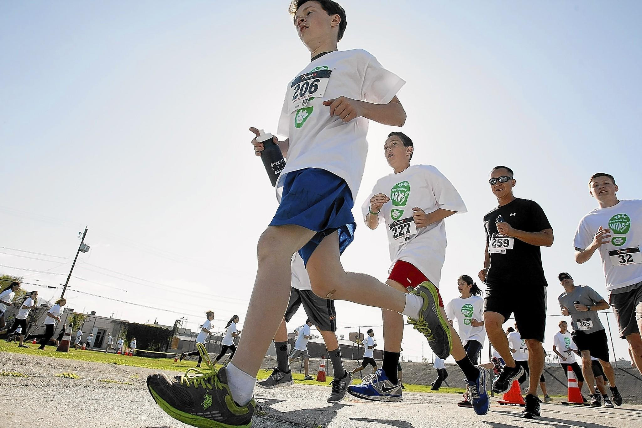 Jordan Middle School held a 5K walk/run in honor of student Christopher Wilke, a 12-year-old Burbank boy who died last month from a rare bile duct cancer, at the Burbank school on Saturday, April 5, 2014. Proceeds benefit the Talbert Foundation.