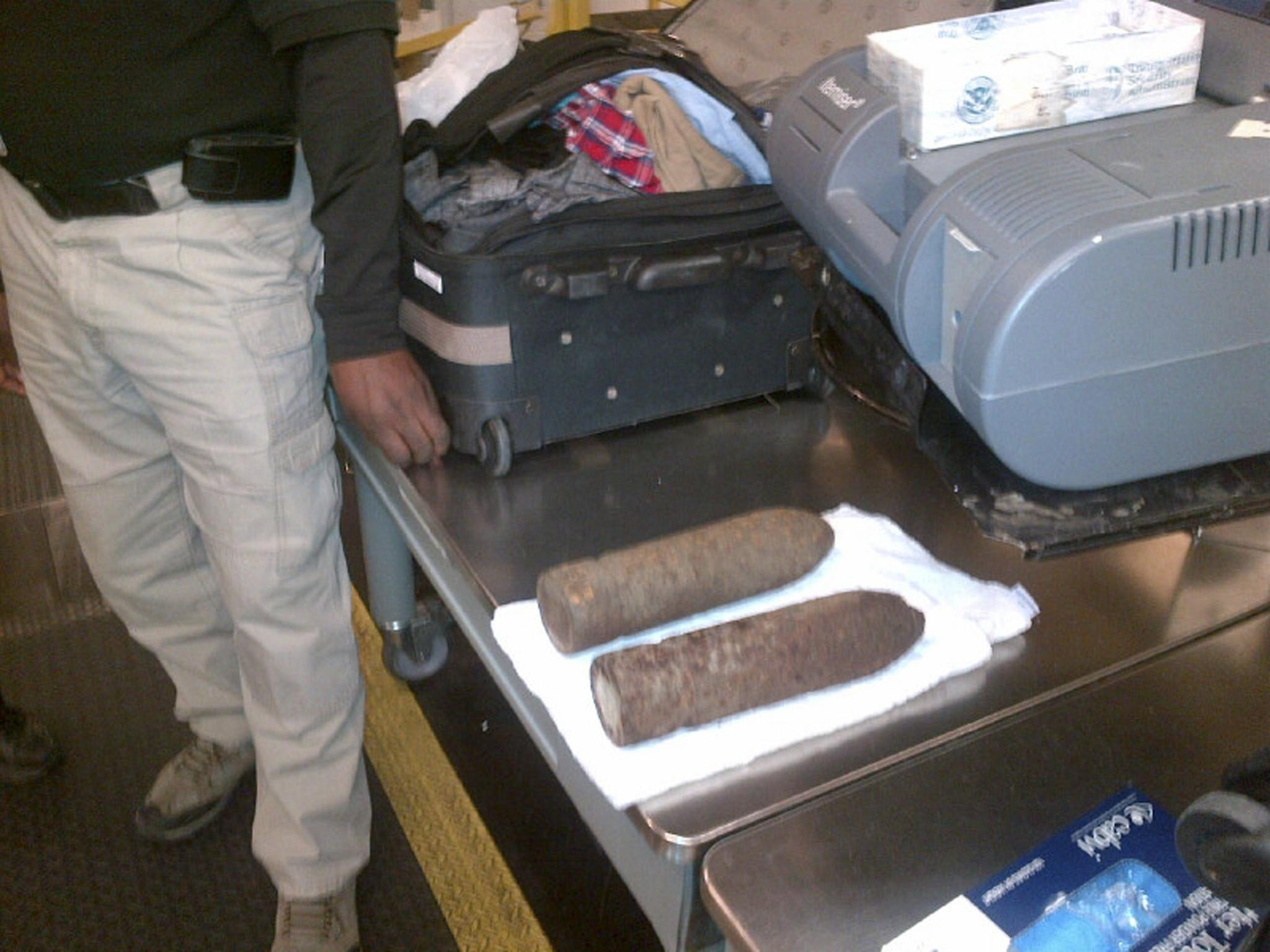 A U.S. Transportation Security Administration photo shows two military-grade shells in checked baggage at Chicago O'Hare International Airport. Two minors were interviewed by Chicago police and FBI after TSA officers at Chicago O'Hare International Airport spotted two military-grade shells in their checked baggage.