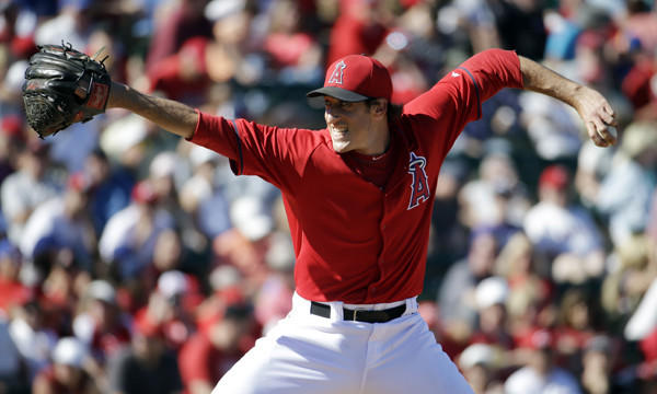 Angels reliever Brian Moran throws during an exhibition game against the Cincinnati Reds in March. Moran is scheduled to undergo Tommy John surgery this week.