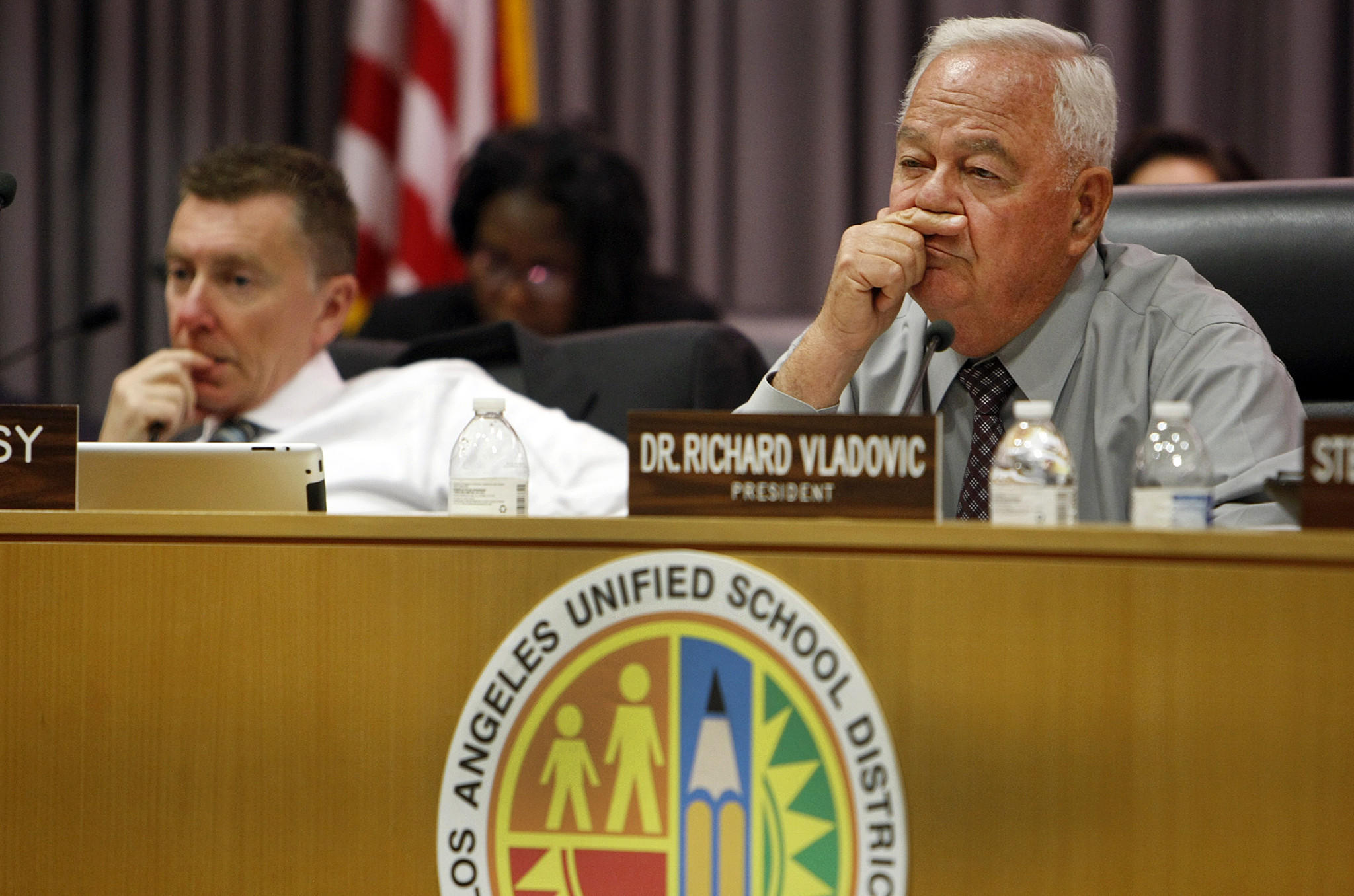 Supt. John Deasy, left, and Richard Vladovic listen during a board meeting. The four schools -- formerly known as Collins Street, Highlander, Oso and Platt Ranch elementaries -- have been closed for 30 years and require extensive renovations.