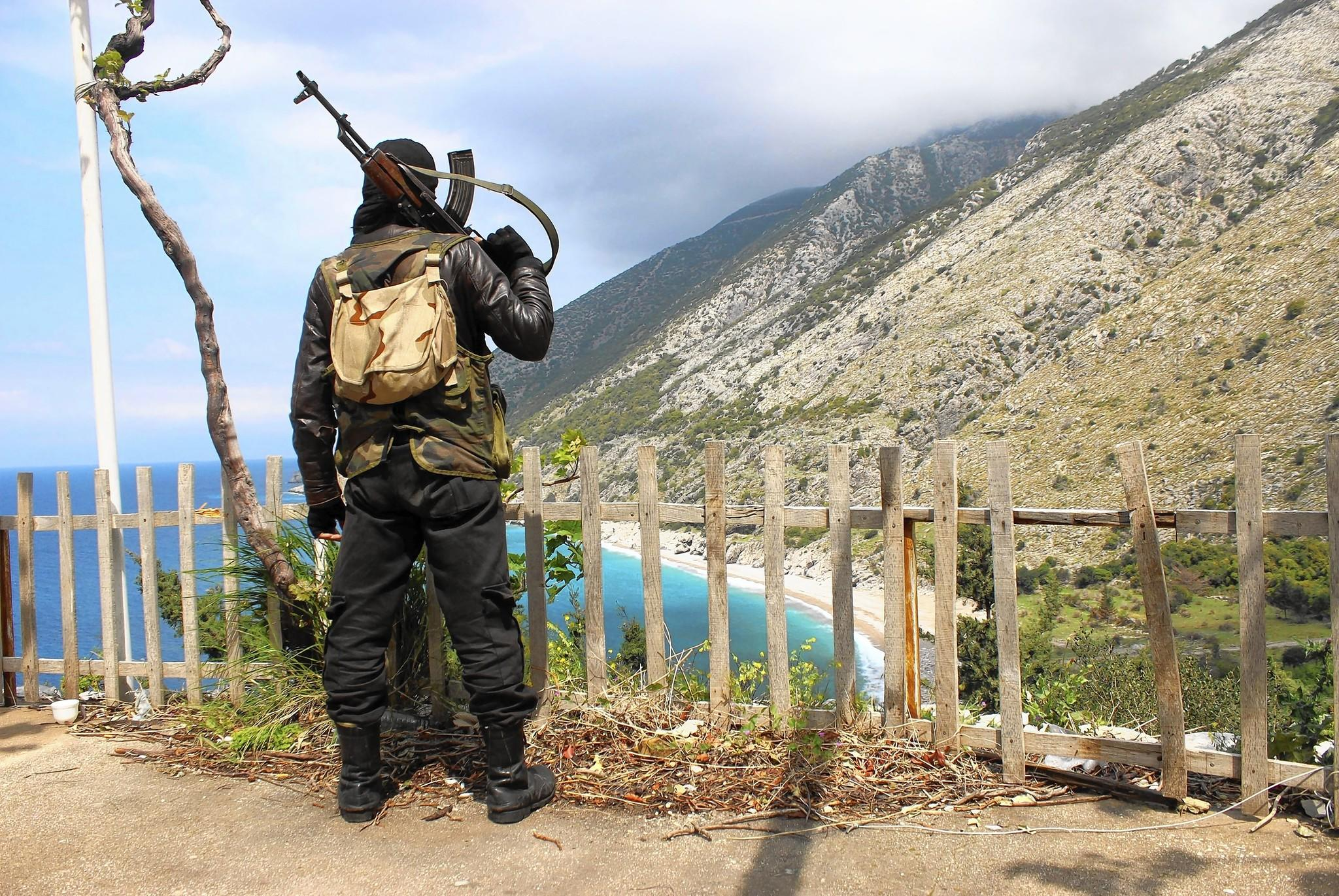 A rebel fighter is seen on a ridge, reportedly in Kasab, Syria, overlooking the Mediterranean Sea. About 2,500 residents, most of them ethnic Armenians, fled Kasab recently as Islamist rebels advanced.