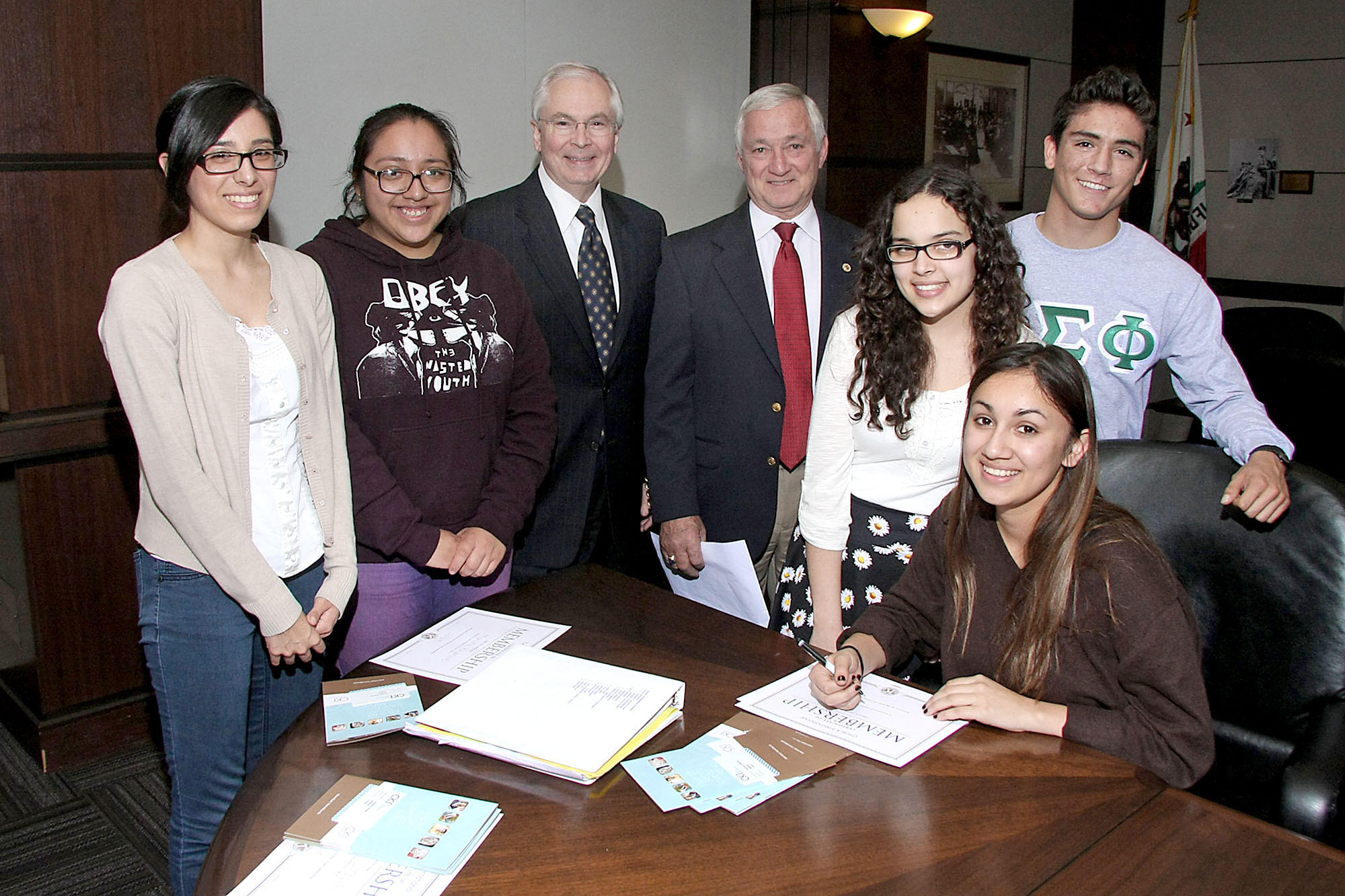 Student members of the Circle K club at Woodbury University, from left, Cassandra Perez, Alejandra Martinez, Veronica Calabrese, Andrea Alejandre and German Paredes with Burbank Noon Kiwanis members Barry Ross, center left, and Ron Rothacher.