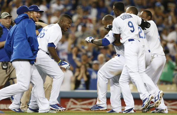 Carl Crawford, right center, celebrates with teammates after driving in the winning run in the 10th inning of the Dodgers' 3-2 win over the Detroit Tigers on Tuesday.