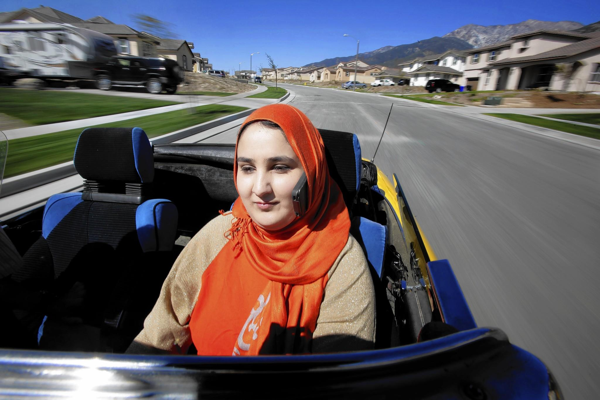 Lena Khan was given a traffic ticket in Glendale for talking on her cellphone, which was tucked into her head scarf, while driving. She's fighting it.