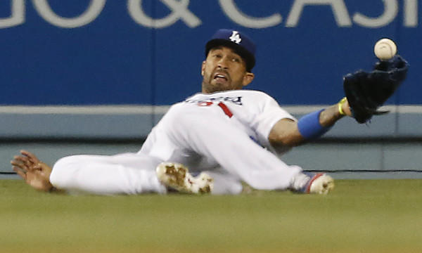 Dodgers center fielder Matt Kemp can't come up with a catch on a run-scoring single by Detroit's Victor Martinez during the ninth inning of Tuesday's game. The Dodgers went on to win the game in the 10th inning, 3-2.