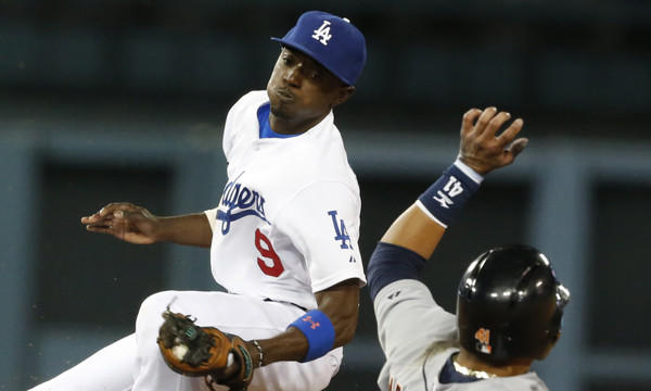 Dodgers shortstop Dee Gordon tags out Detroit Tigers baserunner Victor Martinez on a stolen base attempt during the ninth inning of the Dodgers' eventual 3-2 win in 10 innings Tuesday.