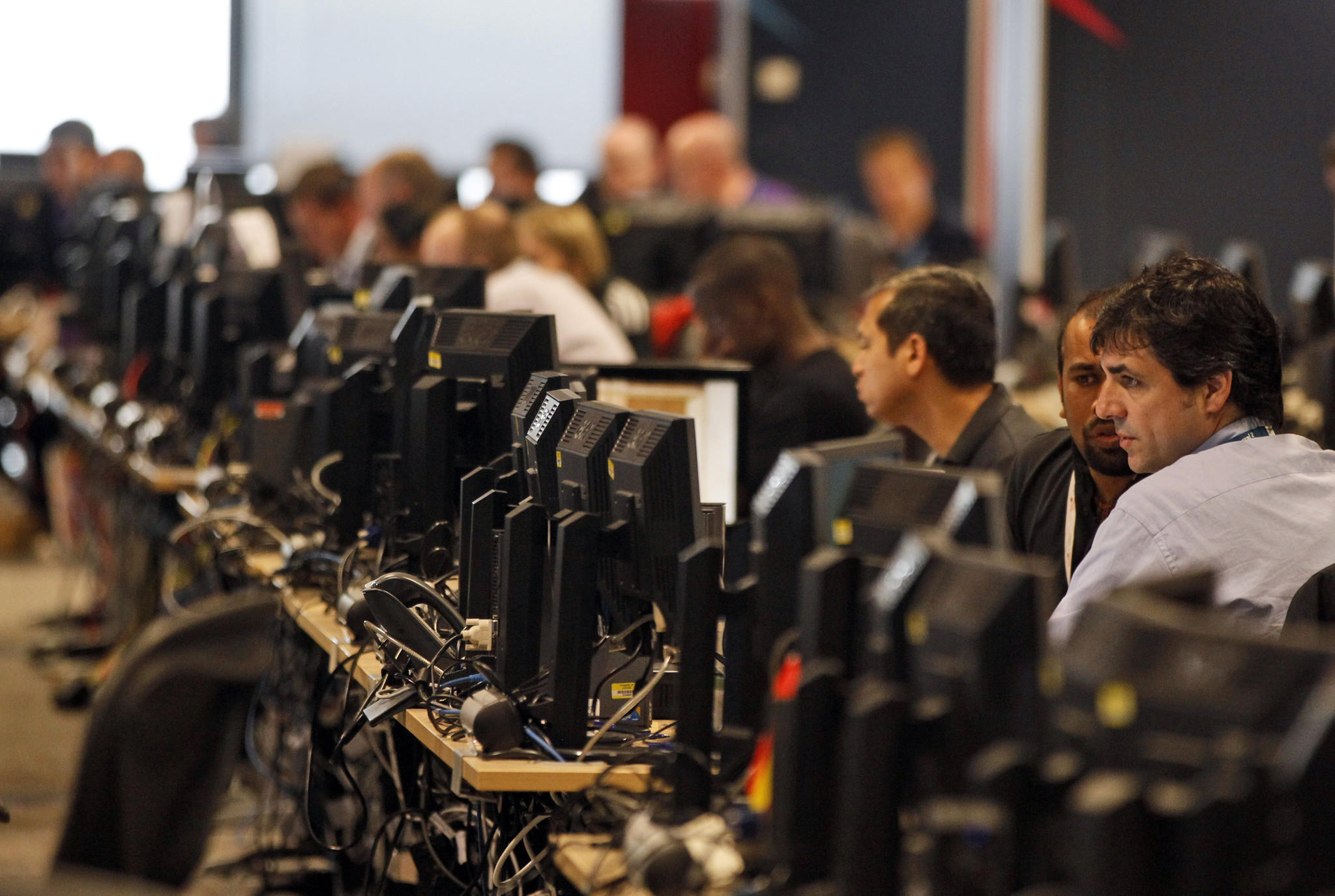 Technology experts at work at the London 2012 Olympics in London. Security experts recommend that users change the passwords for all their online services to protect themselves from the dangers of the Heartbleed bug. However, it is also recommend to wait a day or two before doing so.