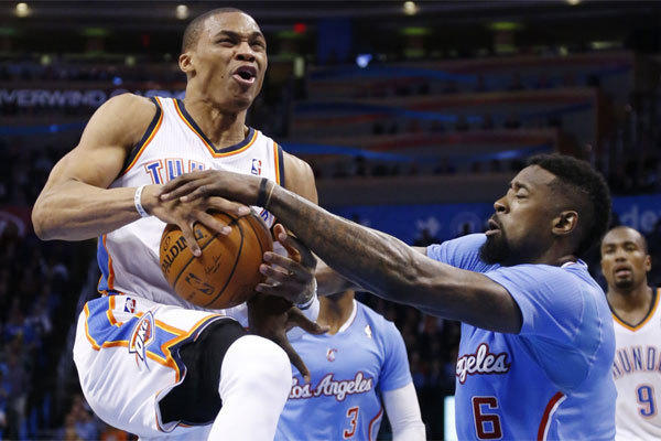 Clippers center DeAndre Jordan attempts to take the ball from Oklahoma City guard Russell Westbrook in the teams' last meeting on Feb. 23 in Oklahoma City. The Clippers won, 125-117.