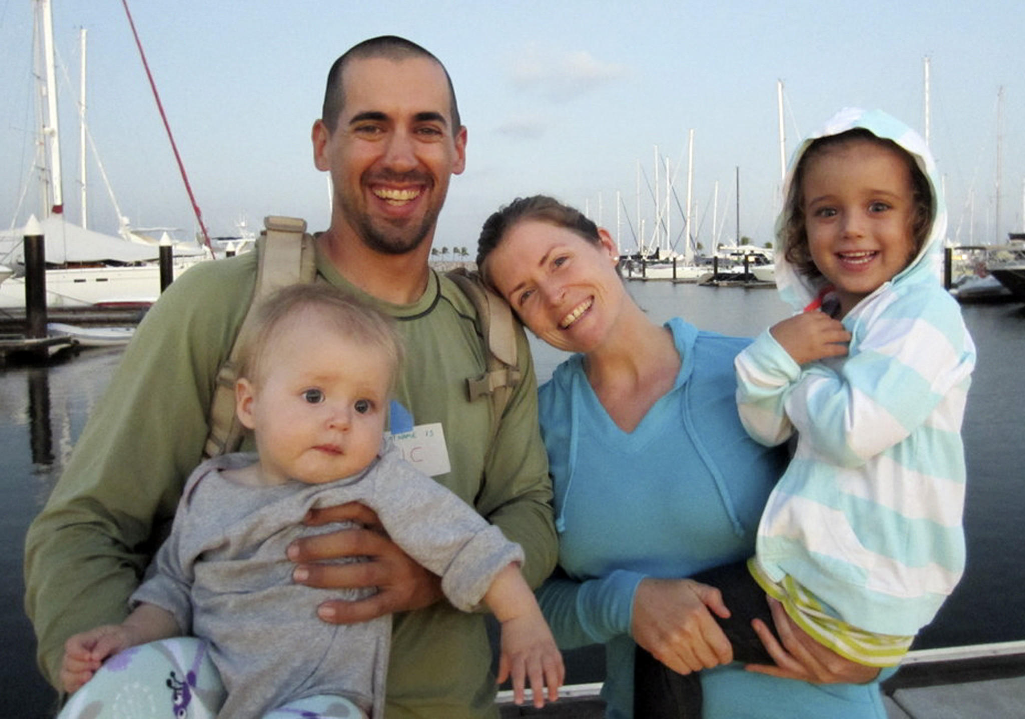 Eric and Charlotte Kaufman with their daughters Lyra, 1, left, and Cora, 3. The family arrived in San Diego on Wednesday aboard the Navy warship that rescued them.