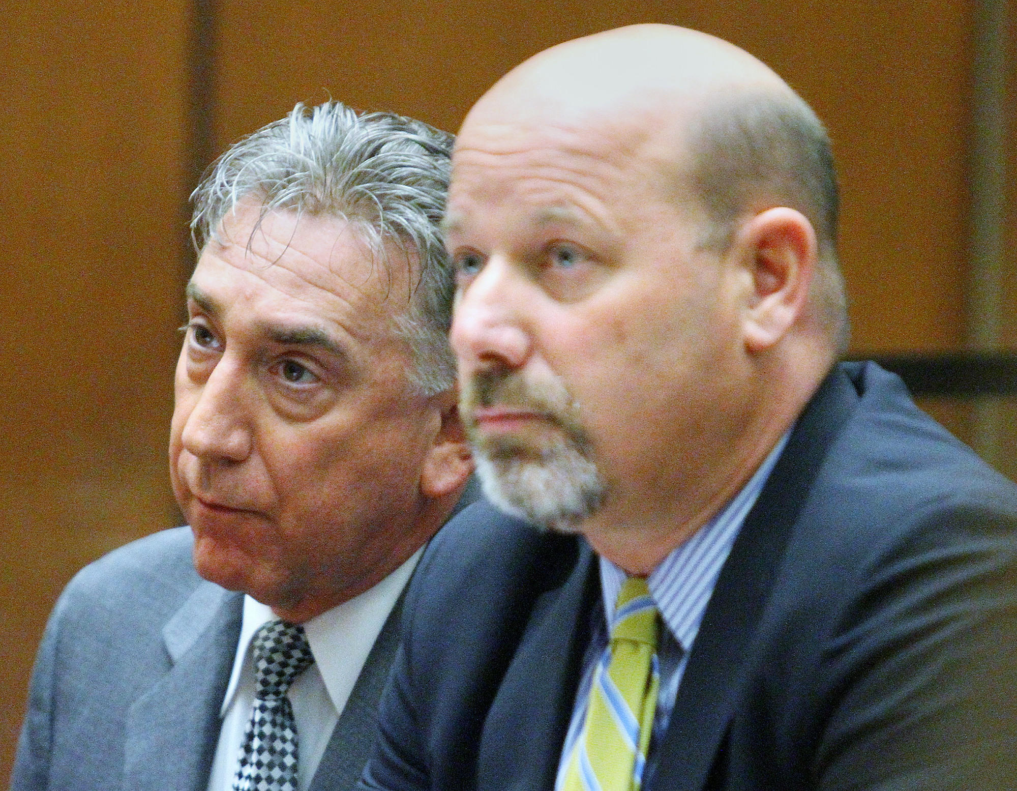 Ex-Glendale Mayor John Drayman, left, with his attorney Sean McDonald, at his sentencing in Los Angeles County Superior Court on Monday.