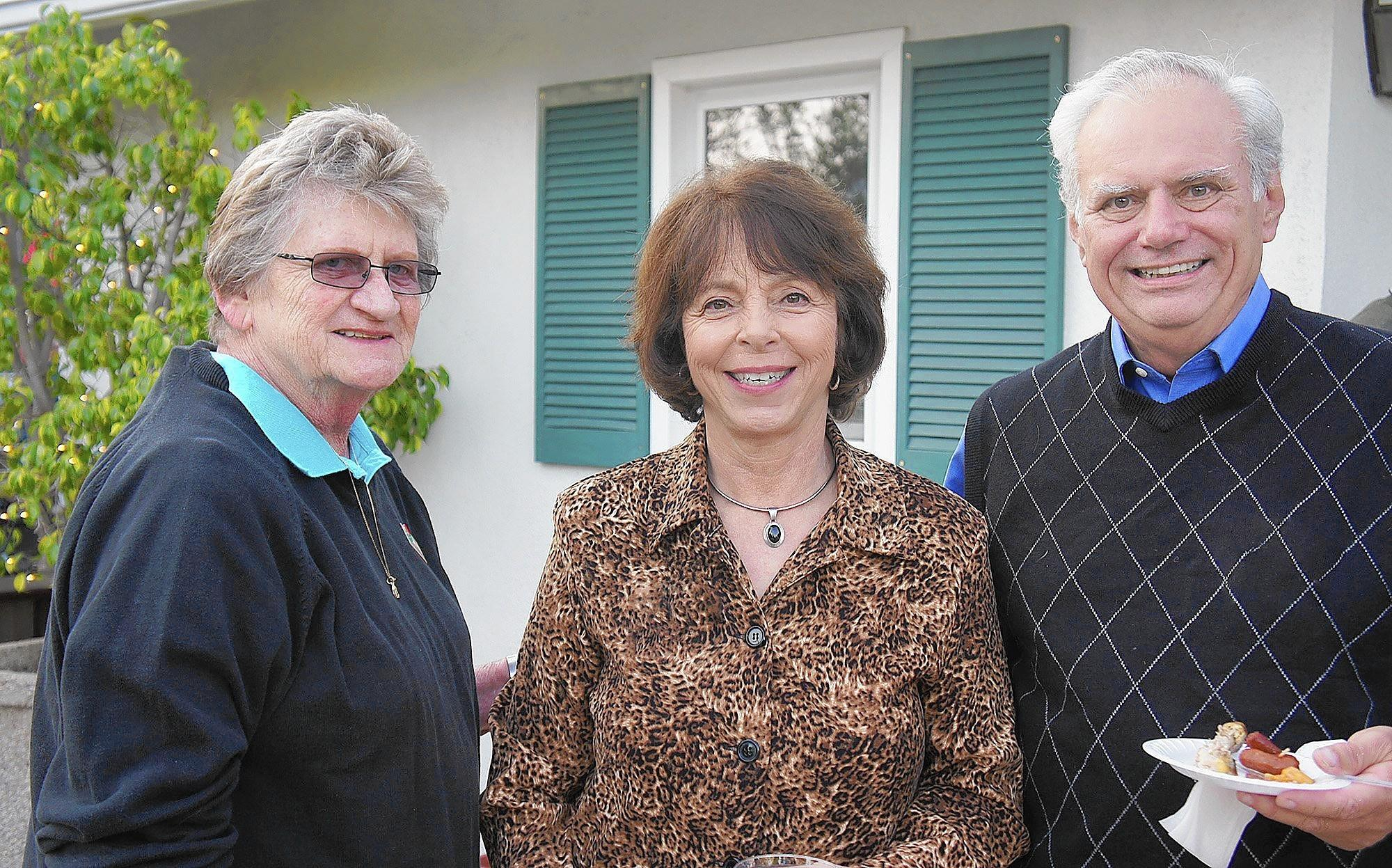 Harriett Hughes, left, catches up with Martha and Tom Burns at the Happy Hour held in support of La Cañada's float in next January's Rose Parade.