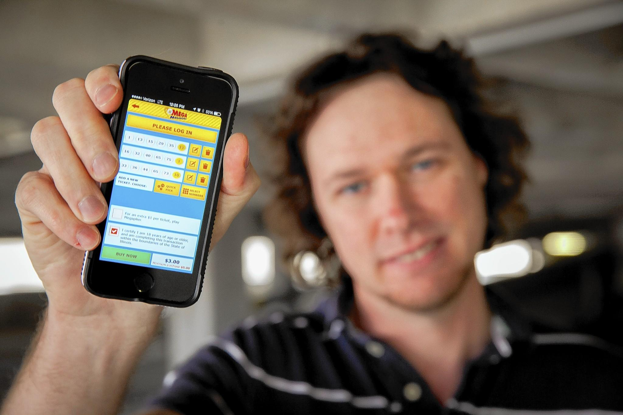 Matthew Ruder, of Pekin, Ill., displays the Illinois Lottery app on his smartphone this month in Peoria, Ill. Ruder likes the convenience of the app for buying tickets.