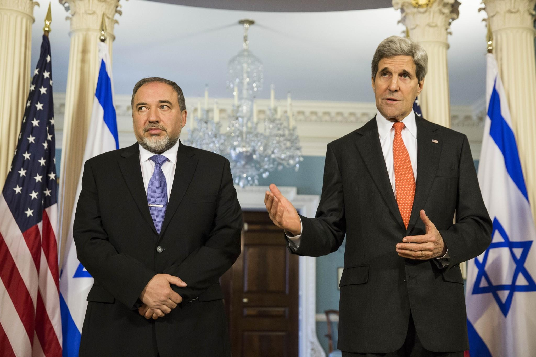 Israeli Foreign Minister Avigdor Lieberman, left, and Secretary of State John Kerry speak to the media before meeting privately at the U.S. State Department.