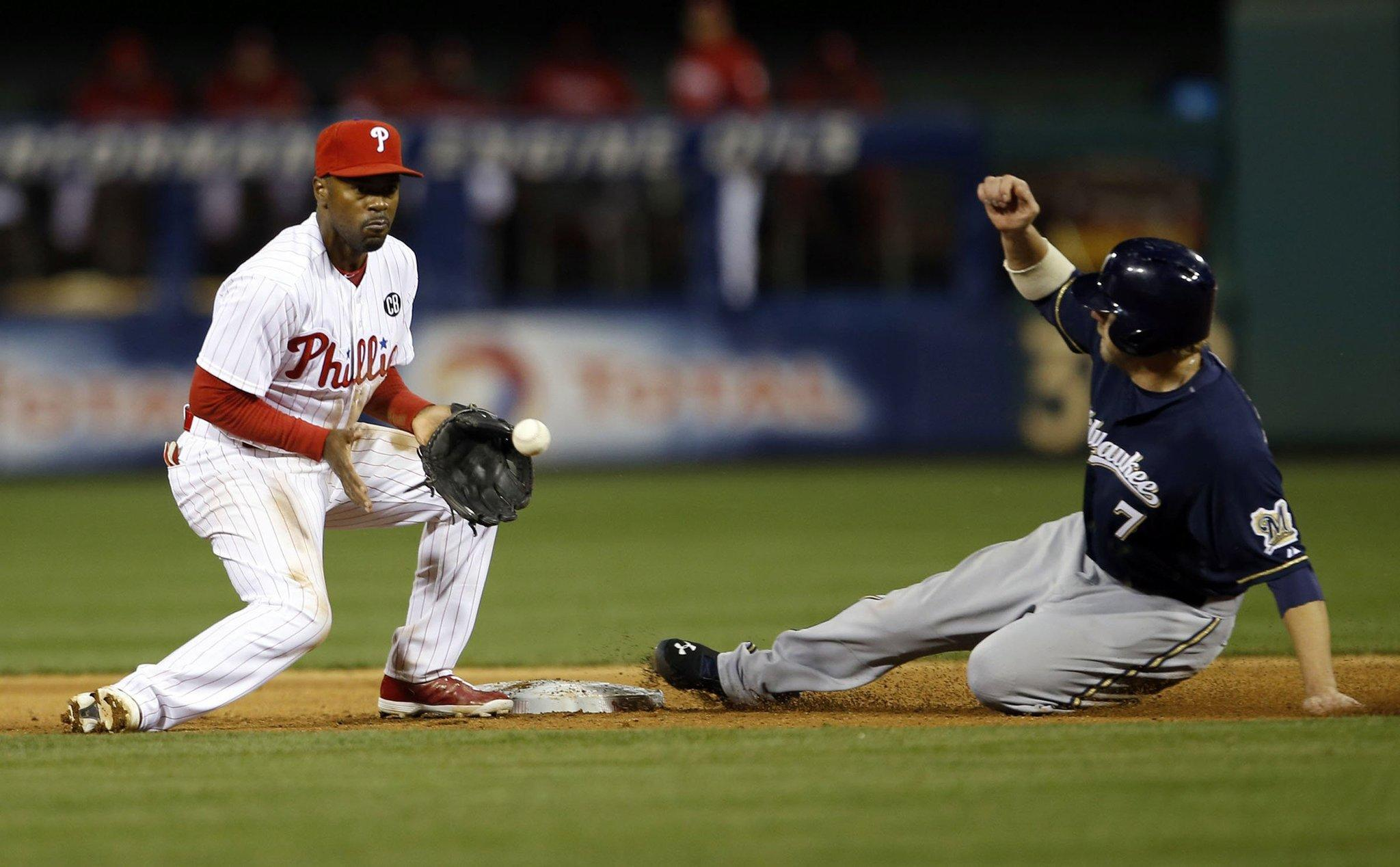 The Milwaukee Brewers' Mark Reynolds, right, steals second base against Philadelphia Phillies shortstop Jimmy Rollins in the eighth inning at Citizens Bank Park in Philadelphia on Wednesday, April 9, 2014. The Brewers won, 9-4.