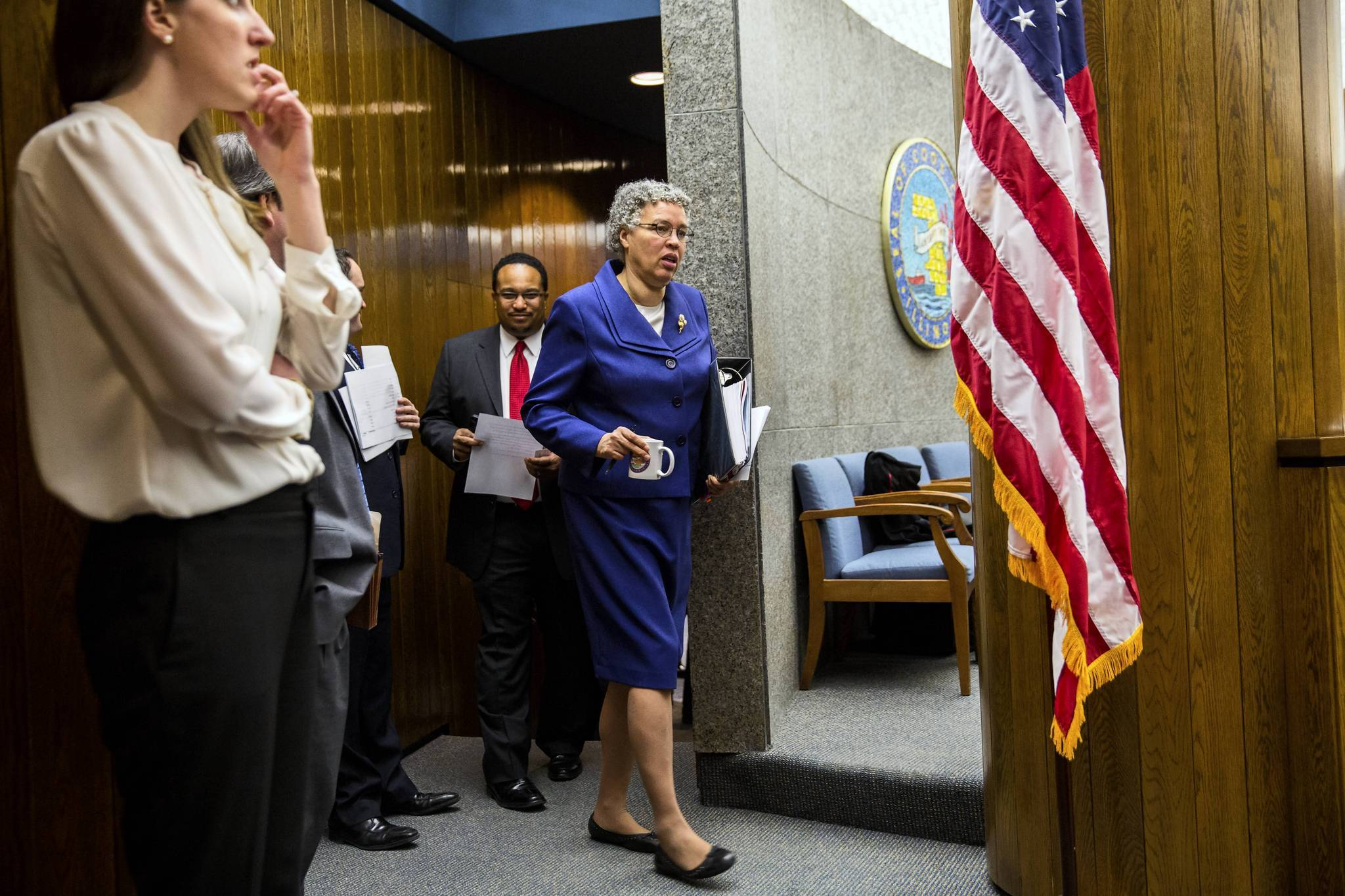 President Toni Preckwinkle arrives for the Cook County Board meeting in Chicago on Wednesday.