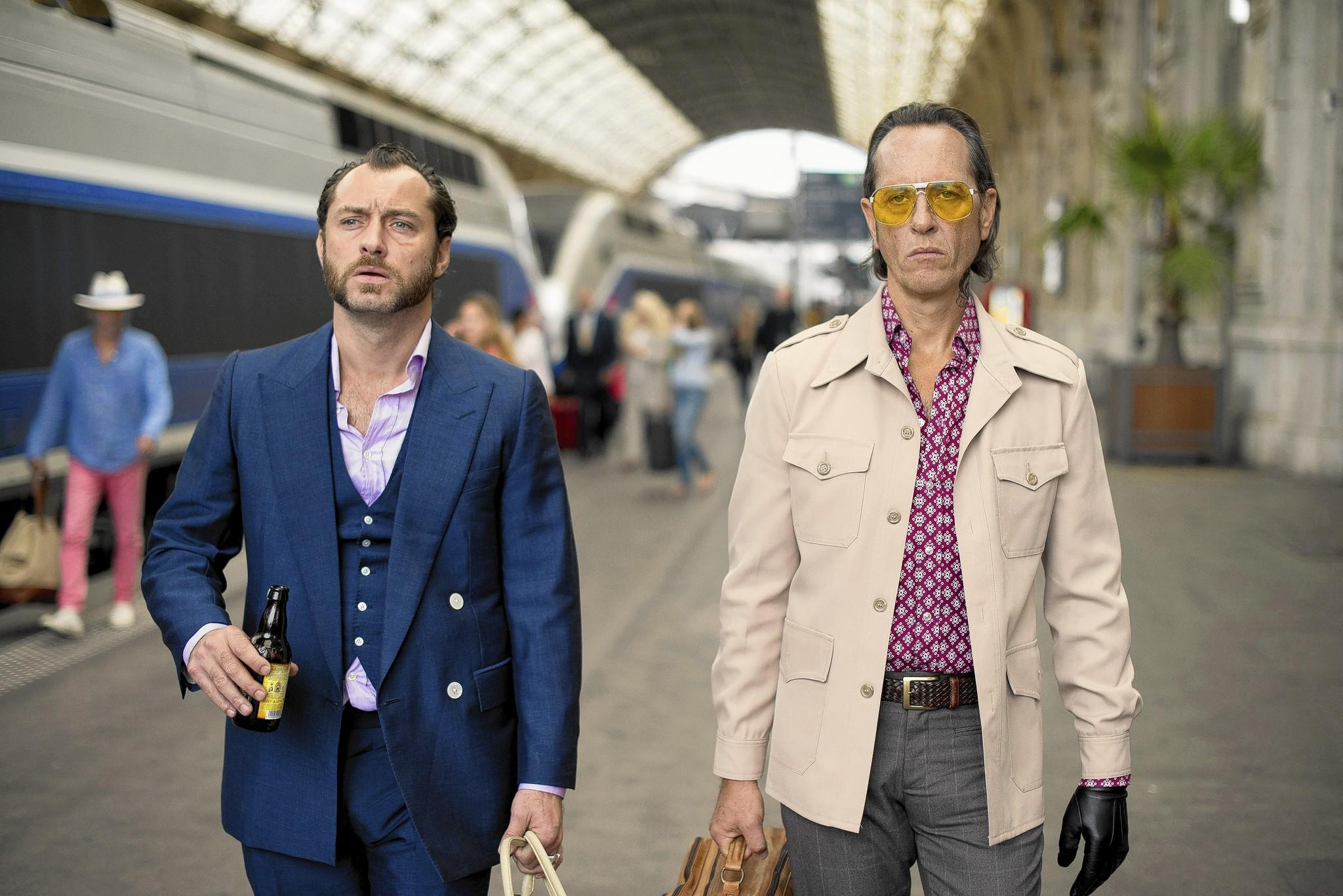 "Jude Law and Richard E. Grant in ""Dom Hemingway."""
