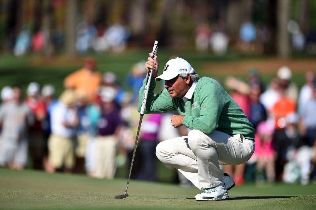 Fred Couples lines up a putt Thursday during the first round of the 78th Masters Golf Tournament at Augusta National Golf Club.