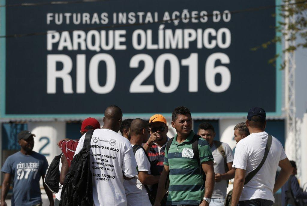 Striking workers stand in front the entrance of Olympic Park in Rio de Janeiro earlier this week.