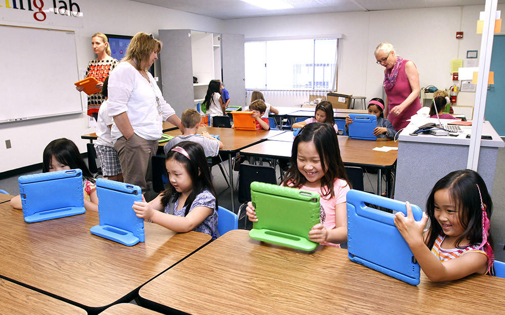 First graders at Palm Crest Elementary School's iPad Learning Lab learn how to use new apps for the iPad in La Canada Flintridge on Tuesday, April 8, 2014. The school district recently opened 3 elementary school iPad Learning Labs with donations from the Educational Foundation.