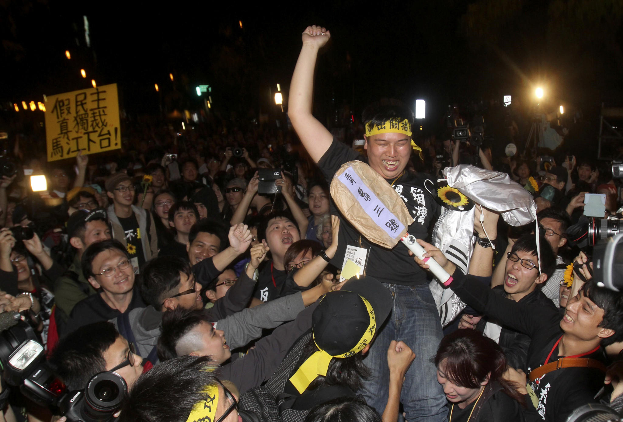 Protesters against a Taiwanese trade pact with China cheer after leaving the legislature in Taipei.