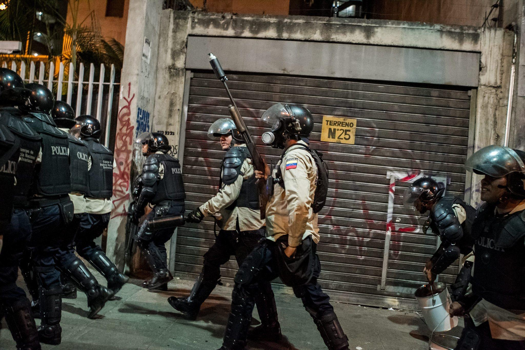 Venezuelan police clash with anti-government demonstrators in Caracas.