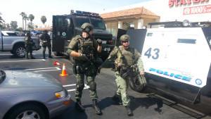 Tustin police search for gunman.