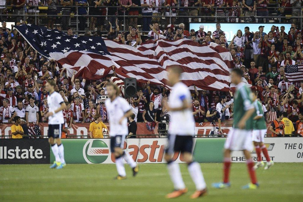 Fans unfurl a large U.S. flag as the U.S. men's soccer team plays Mexico in a friendly on Sept. 10, 2013, in Columbus, Ohio.