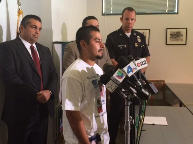Oscar Reyes speaks at a news conference Thursday announcing a reward for information in the fatal fire that killed his girlfriend and their 1-year-old son.